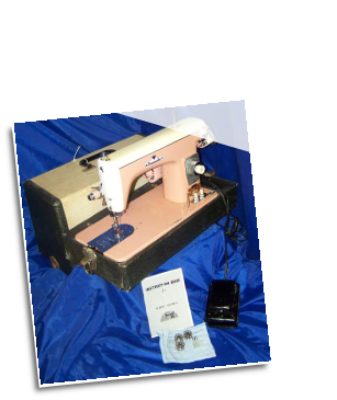 DRESSMAKER 303 SUPER DELUXE PINK/WHITE SEWING MACHINE